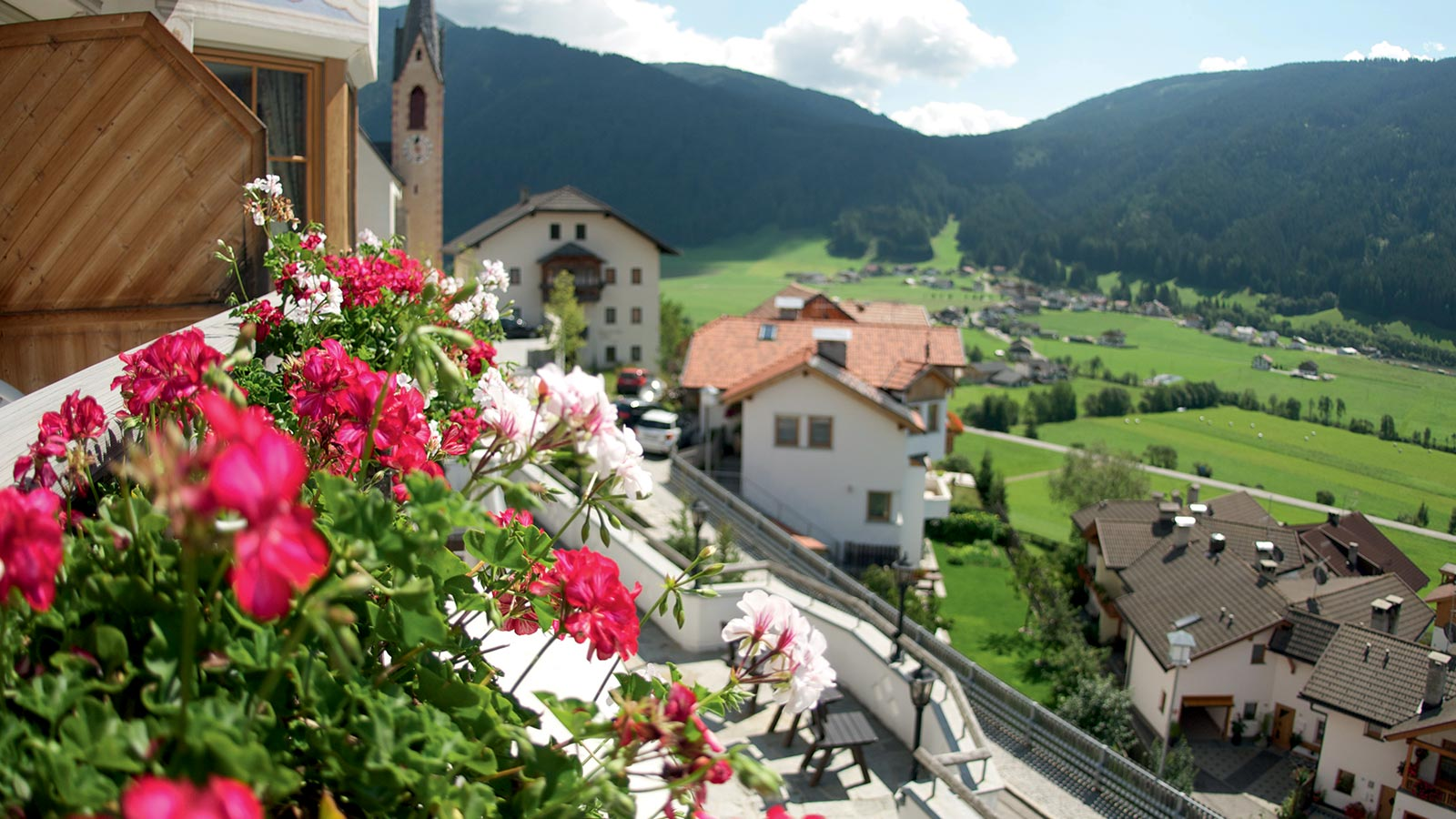 View from the balcony of one of the rooms at Hotel Gschwendt on the green meadows of Val Casies