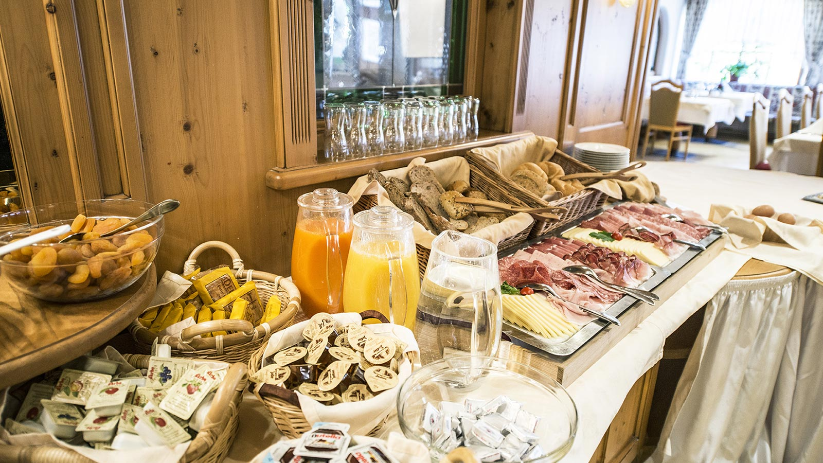 Rich breakfast buffet at our hotel in Val Casies with numerous juices, sweets, cold cuts and jams.