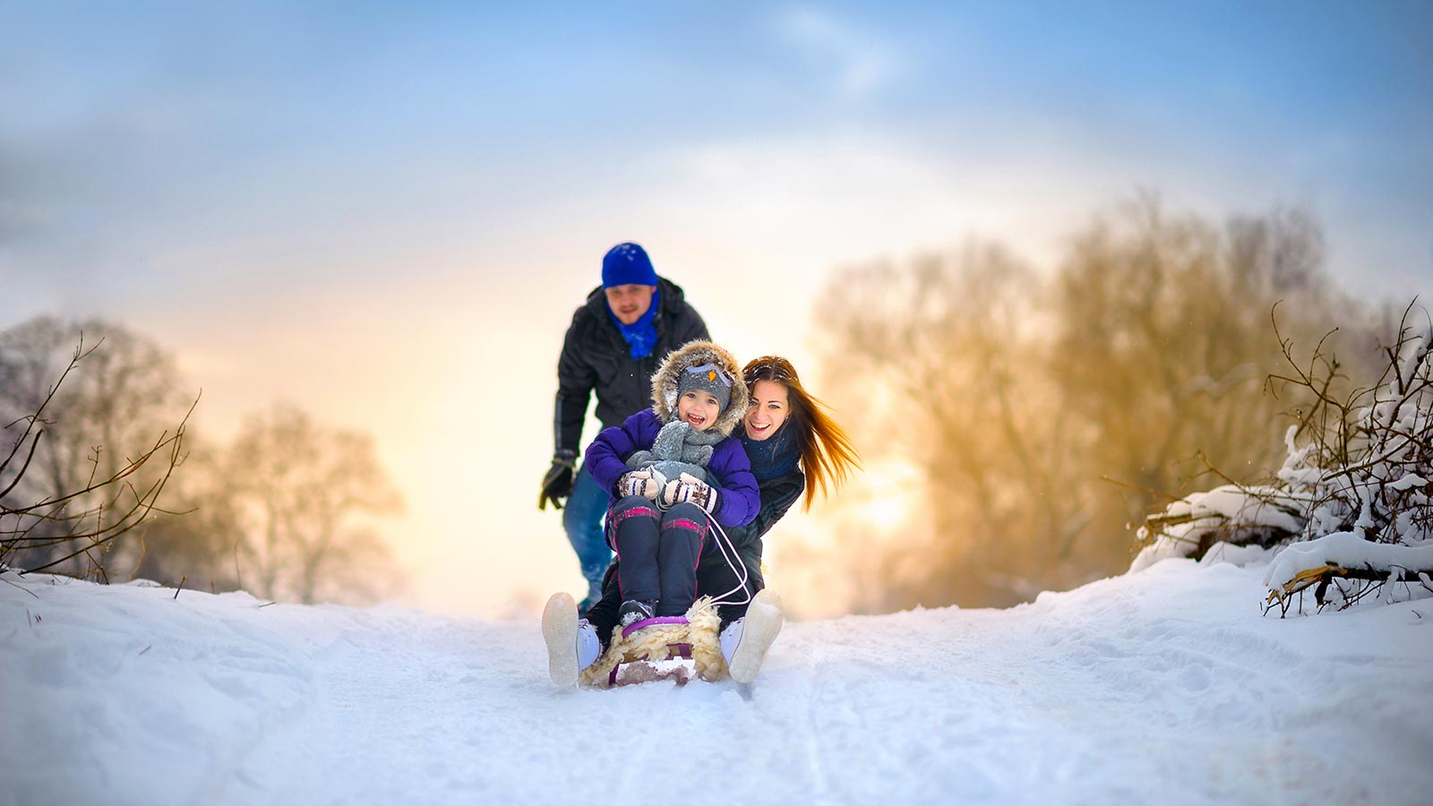 a happy family on a sledge
